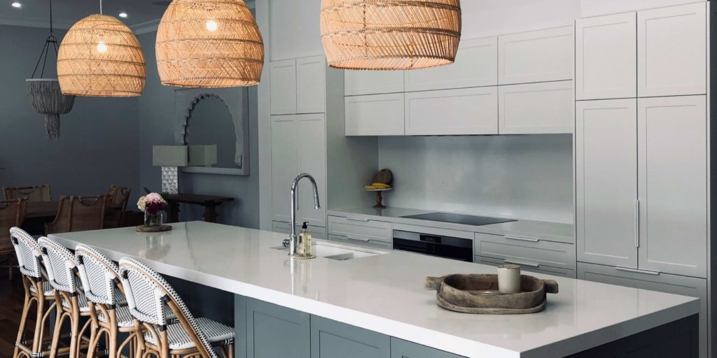 Grey kitchen with island bench and pendant lighting